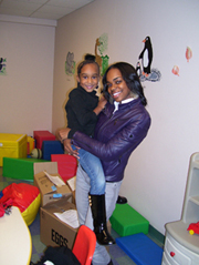 Photo of student in Moore Complex play room